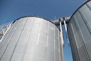 Big metal fuel tanks and deep blue sky