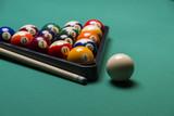 Billiard balls arranged in a triangle;selective focus on  balls