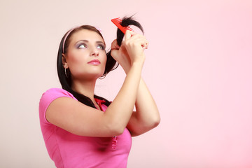 Childish woman infantile girl combing hair.