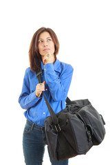 Pensive woman daydreaming going on vacation with travel bag