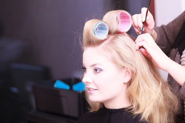 Beautiful blond girl hair curlers rollers hairdresser