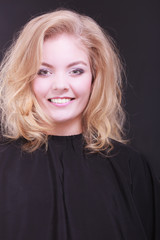 Beautiful smiling girl with blond wavy hair in hairdressing