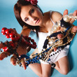 summer girl with plenty of jewellery, beads in hands