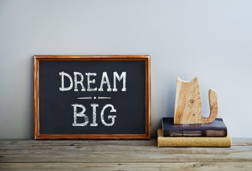 motivational poster quote DREAM BIG on the white wa