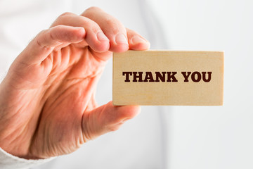 Thank You Text on Small Piece Wood Hold by Hand