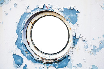 Empty round porthole in white and blue ship wall