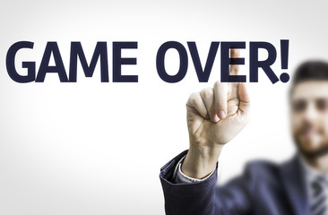 Business man pointing the text: Game Over
