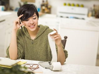 Multi-ethnic Young Woman Smiling Over Financial Calculations