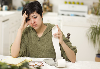 Multi-ethnic Young Woman Agonizing Over Financial Calculations