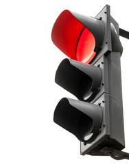Black traffic lights with red stop signal isolated on white