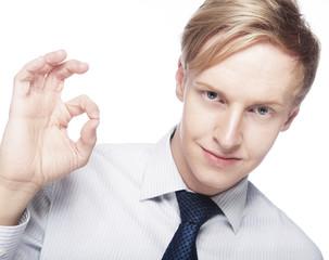 Man gesturing success sign.