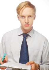 Young businessman with pen and documents