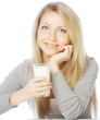 young woman holding a glass of fresh milk