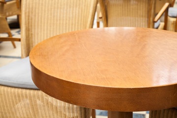 Empty round wooden table in the restaurant
