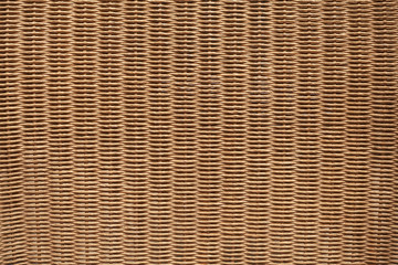Brown wicker furniture surface. Background photo texture