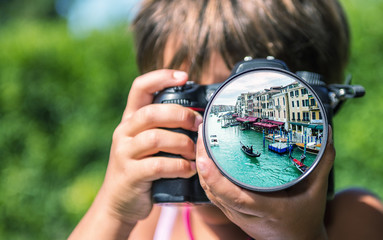 Young girl taking photos of Venice Grand Canal by professional d