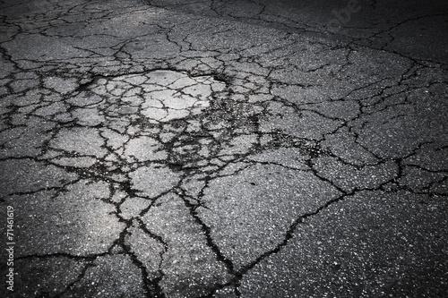Leinwandbild Motiv Dark asphalt road with cracks. Background texture