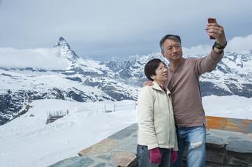 Tourist taking selfie on Mountain Matterhorn, Switzerland