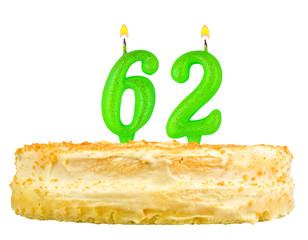birthday cake with candles number sixty two isolated on white