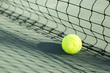 A new tennis ball in hard court.