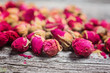Closeup of dried rose buds on old wooden table