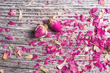 background with rose petals and two dried flowers