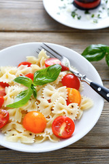 appetizing pasta farfalle with tomatoes