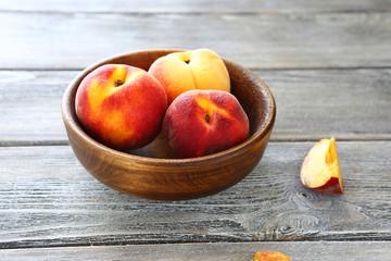 fresh sweet peaches in a bowl