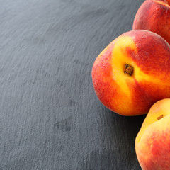 Fresh peaches on grey background