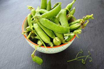 fresh peas in a white bowl