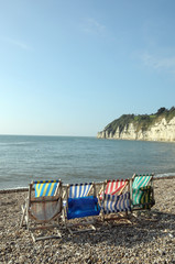 Deckchairs on beach at Beer in South Devon