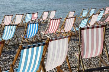 Deckchairs on beach at Beer in South Devon