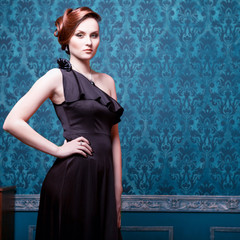 Woman in evening dress in vintage room