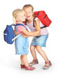 Two sisters with school bags going to school together.