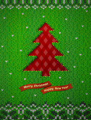 Christmas tree like hole in knitted background. Jumper fragment