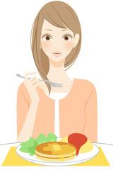 食事をする笑顔の女性