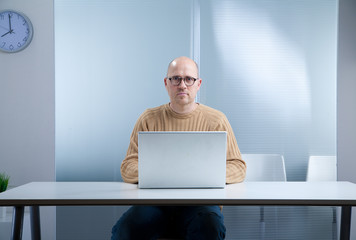 hipster nerd bald with laptop