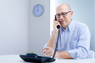serene office worker on the telephone