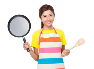 Housewife with pan and spatula