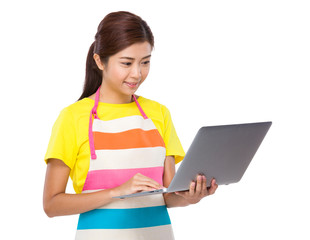 Asian housewife use of laptop computer