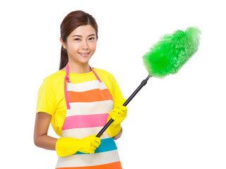 Asian housewife with brush