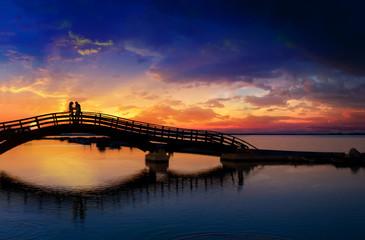 Couple enjoying the romantic sunset on the Lefkas town bridge