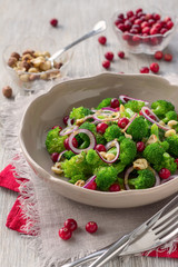 Broccoli salad with fresh cranberries, nuts and mustard dressing