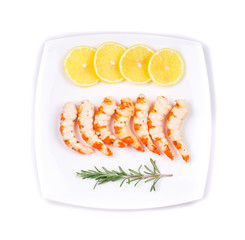 Cooked unshelled shrimps with lemon.