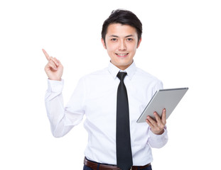 Business man use of tablet and finger point up