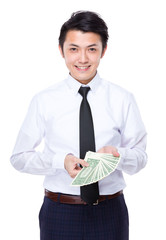 Businessman hold lots of american banknote