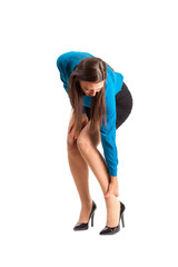 Woman in high heels touching her ankle