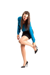 Business woman holding ankle