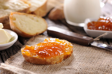 Apricot jam for breakfast on bread