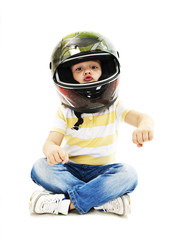 Boy with a helmet, pretending to drive a motorcycle